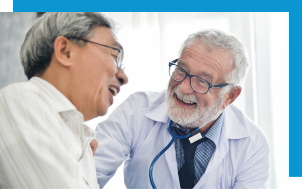 Happy Bearded Doctor Talking And Laughing With His Patient